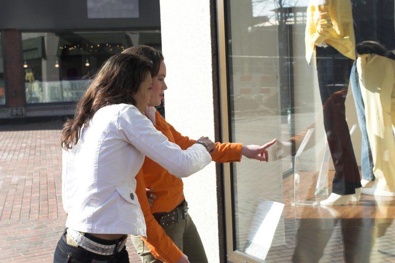 Two women at shop window